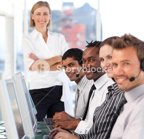 Concentrated female leader with her team on a call center