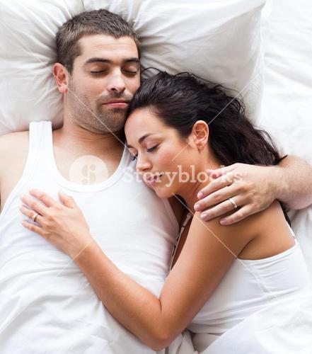 Radiant couple lying on a bed