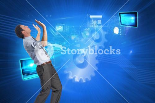 Composite image of businessman posing with arms raised