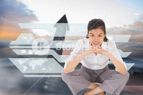 Composite image of smiling businesswoman sitting cross legged