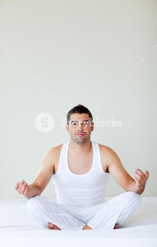 Young man doing exercises in bed