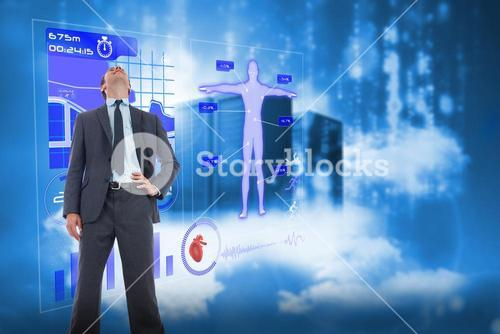 Composite image of happy businessman with hand on hip