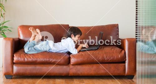 Young kid playing with a laptop
