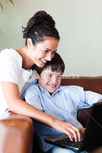 Mother and son playing with a laptop