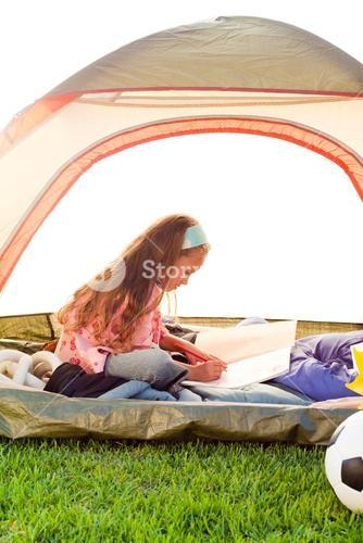 Young girl in tent