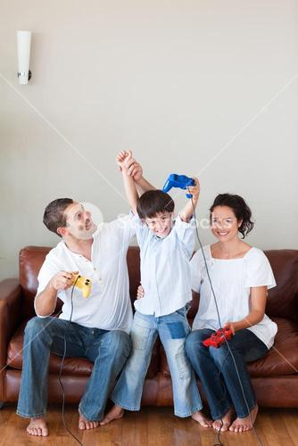 Loving family playing video games in the livingroom