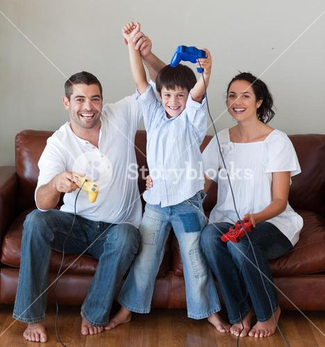 Smiling family playing video games in the livingroom