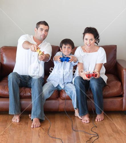 Happy family playing video games in the livingroom