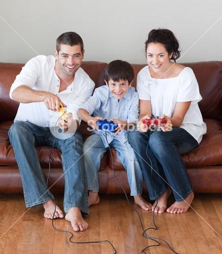 Radiant family playing video games in the livingroom