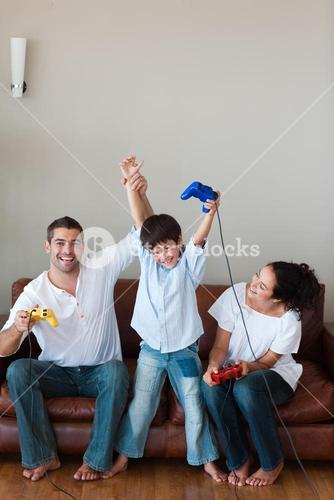 Delighted family playing video games in the livingroom