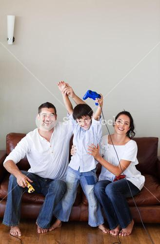 Bright family playing video games in the livingroom