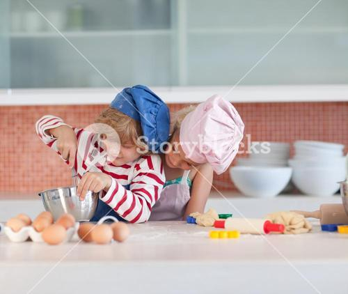 Young children baking at home