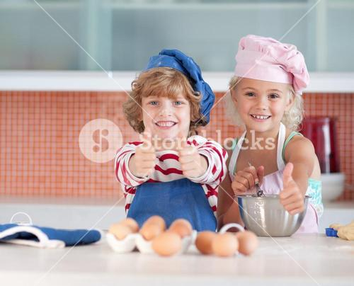 Nice children baking at home