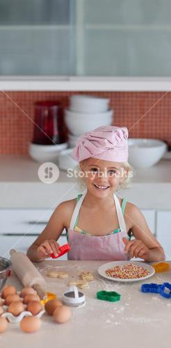 Cute daughter baking at home
