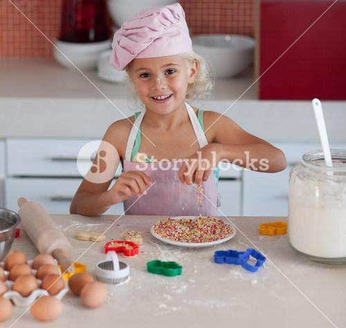 Young girl baking in at home