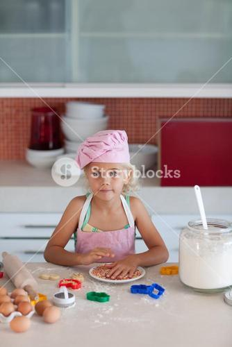 Cute girl baking in at home