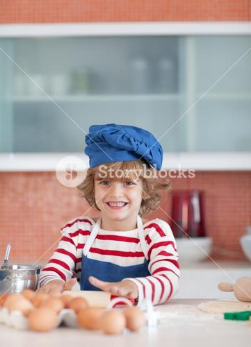 Smiling boy baking at home