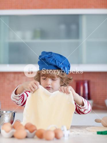 Cute boy baking at home