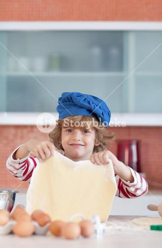 Young boy baking at home