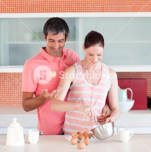 Attractive man and woman cooking at home