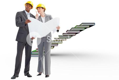 Composite image of business people wearing hard hats are discussing