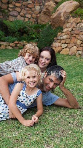 Lovely family resting in a garden