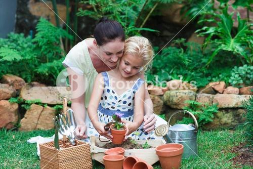 Lovely mother and daughter gardening