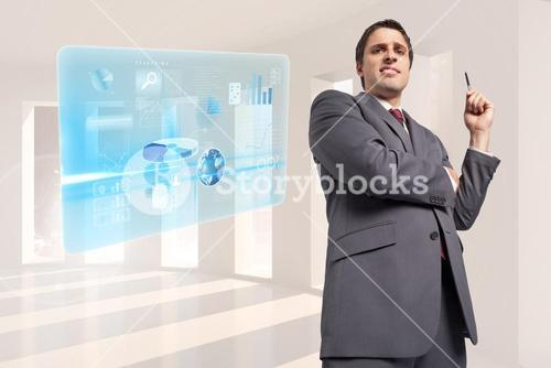 Composite image of thoughtful businessman holding pen