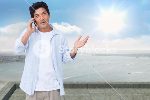 Composite image of clueless male on his cellphone