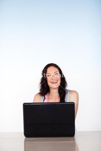 Happy woman working with a laptop with copyspace