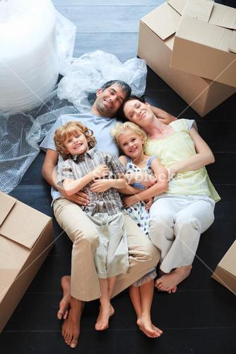 Family sleeping in its new house