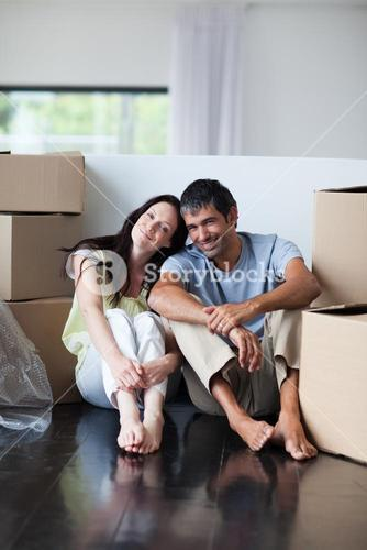 Happy lovers moving house