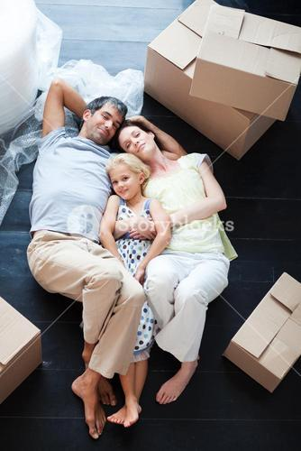 Parents and daughter lying on the floor