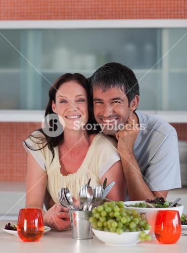Happy couple eating in a kitchen