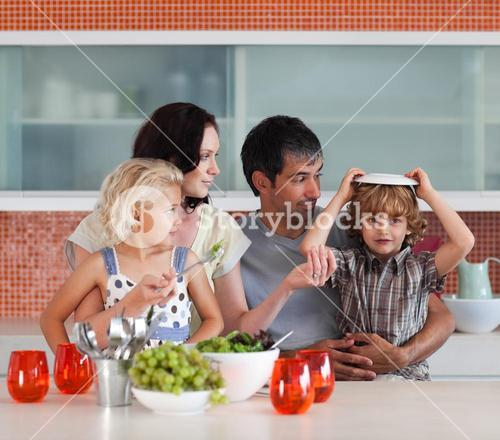 Happy family eating in a kitchen