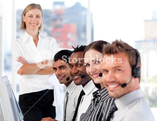 Business team in a call center with a bright female leader