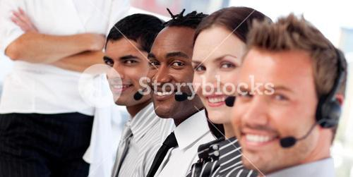 Business team in a call center wearing headset