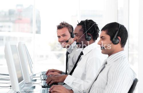 International business team in a call center wearing headsets