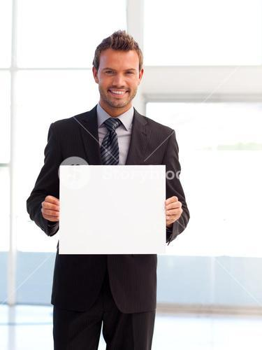 Handsome smiling businessman showing a white card