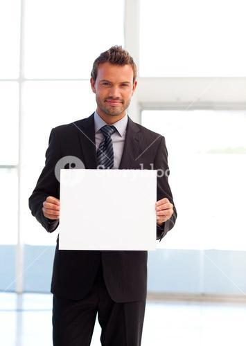Friendly businessman holding a white card