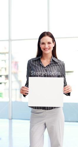 Young woman showing a big business card