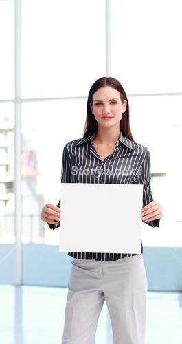 Serious woman showing a big business card