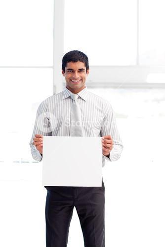 Confident businessman showing a white card