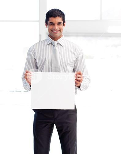 Smiling businessman showing a white card