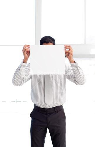 Businessman showing a white card in front of his face