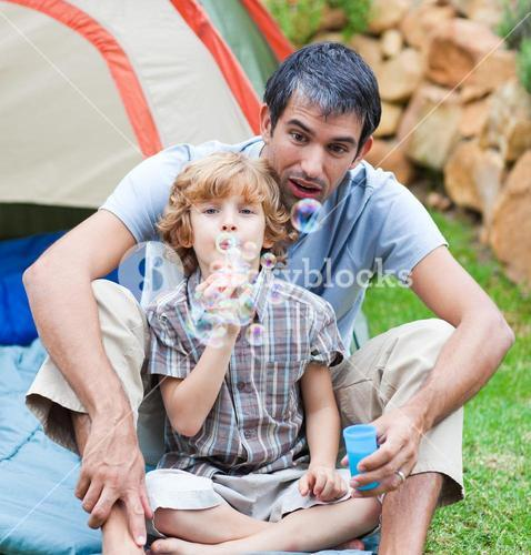 Man and kid blowing bubbles