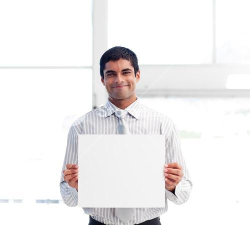 Smiling businessman presenting a white card