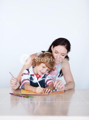Mother and son doing homework with copyspace