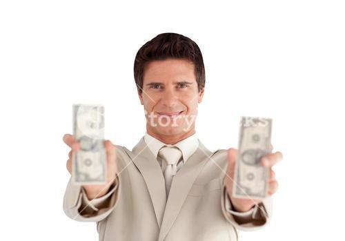 Confident businessman standing at the camera