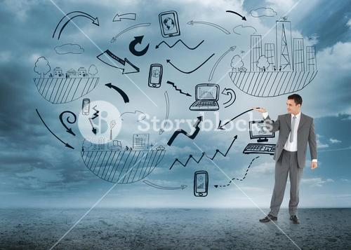 Composite image of businessman looking at what he is presenting